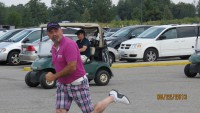 pink and plaid golfer pants on the run