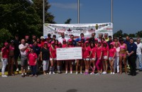 cheque presentation breast cancer charity golf