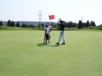 young golfer putting for charity