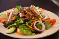salad with steak chicken salmon menu options