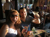 symposium cafe cambridge kitchener ontario couple celebrating with martinis