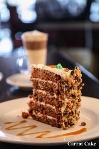 carrot cake symposium dessert signature cranberry walnut cream cheese delicious with cappuccino