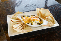 appetizer spinach dip feta cheddar toasted pita bread signature  dish symposium cafe restaurant lounge