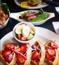 belgium waffles sausage fruit bacon breakfast brunch